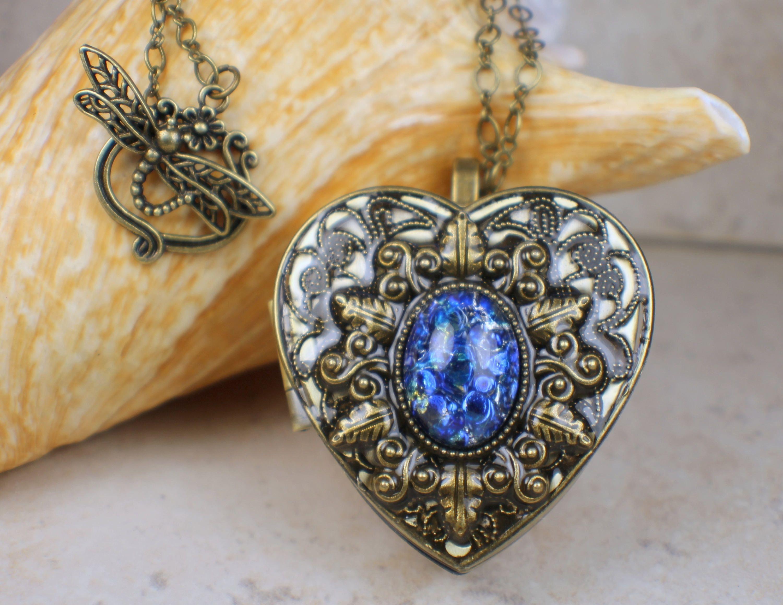 Sapphire blue opal music box locket heart music box pendant music sapphire blue opal music box locket heart music box pendant music box jewelry musical photo locket music box necklace locket necklace pinterest blue aloadofball Images