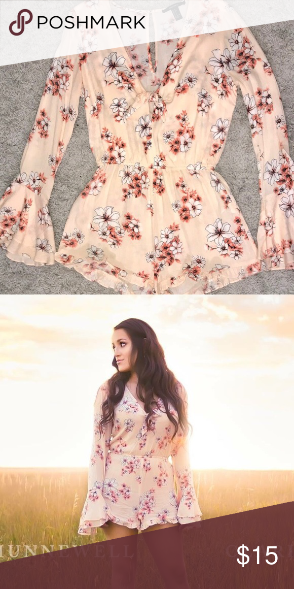 14bc4e84a605 Floral Romper Forever 21 light pink floral romper. Used it once for senior  photos and has just been sitting in my closet sense. Offer away!
