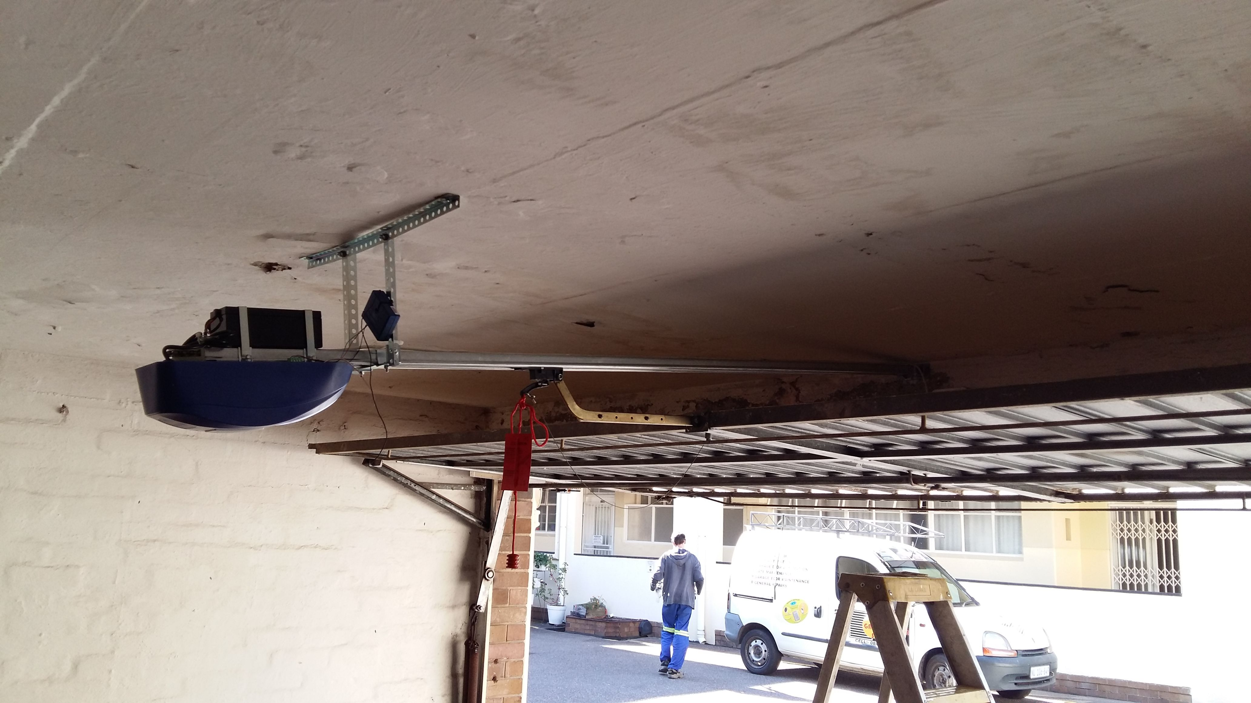 Et Advanced Fitted To A Double Tip Up Garage Door These Motors Have A Soft Start And Soft Stop Which Works Brilliantly On Garage Door Motor Garage Doors Doors