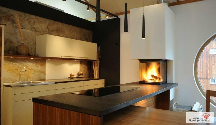 heizkamin in der k che auf arbeitsh he integriert heizkamin designkamin designkamin www. Black Bedroom Furniture Sets. Home Design Ideas