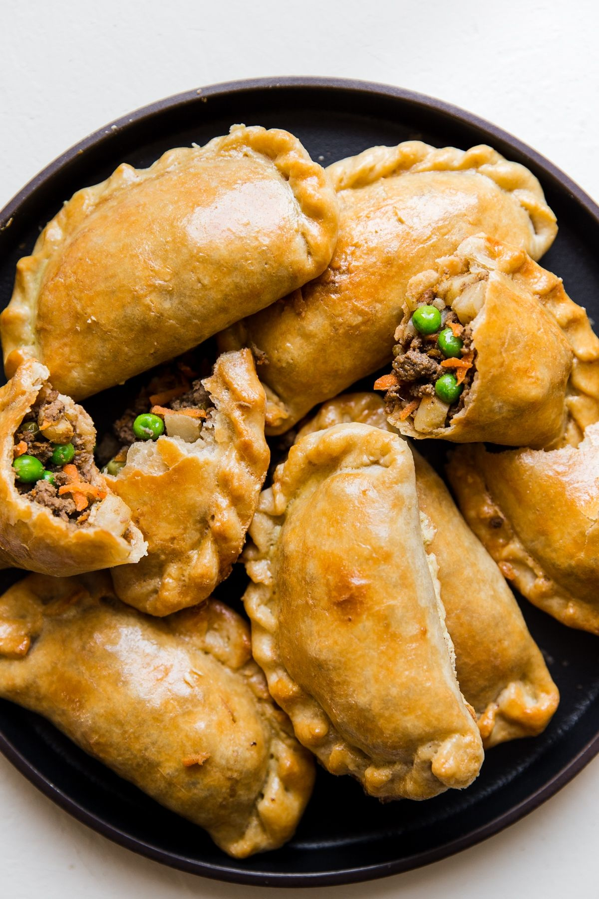 Easy Beef Empanadas Recipe by The Modern Proper ||Tender, flaky crust surrounding a hearty mixture of warmly-spiced ground beef and vegetables—we're going to teach you how to make the best beef empanadas you've ever tasted.