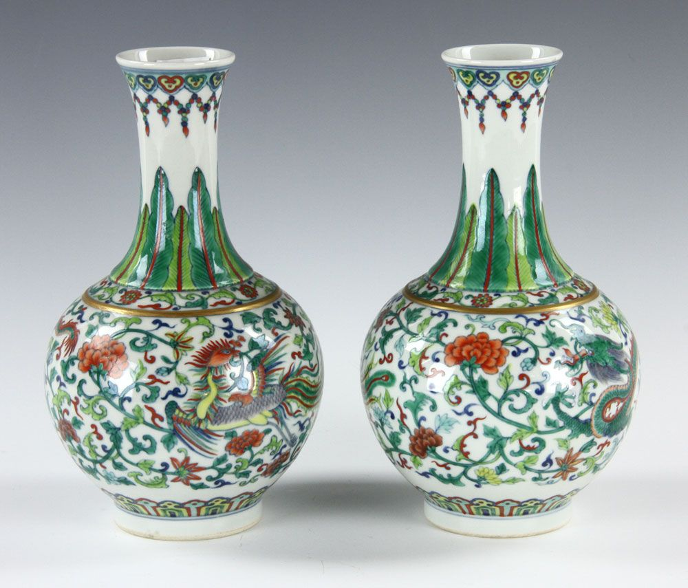 Pair of chinese qing dynasty vases with dragon floral plants and pair of chinese qing dynasty vases with dragon floral plants and birds design yongzheng mark on bases 8 h x w provenance from osgood family reviewsmspy