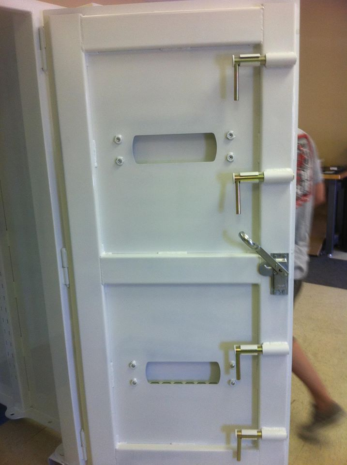 Inside view of an F5 Storm Shelters safe room door. Five locks total to ensure & Inside view of an F5 Storm Shelters safe room door. Five locks total ...
