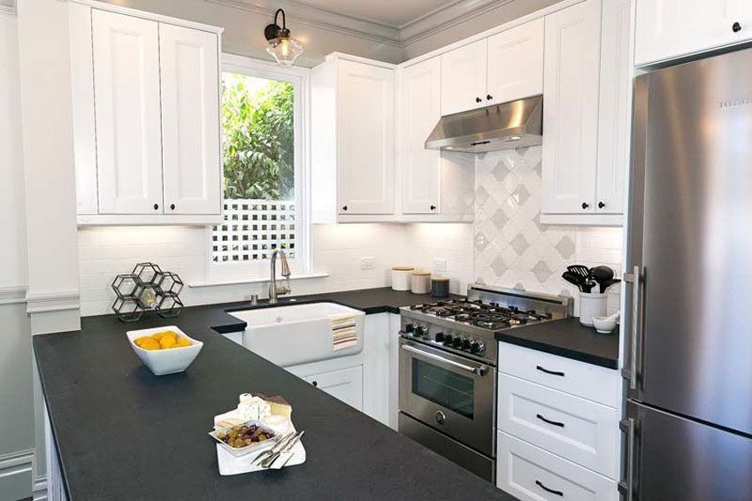 Small U Shaped Contemporary Kitchen With White Cabinets And Black
