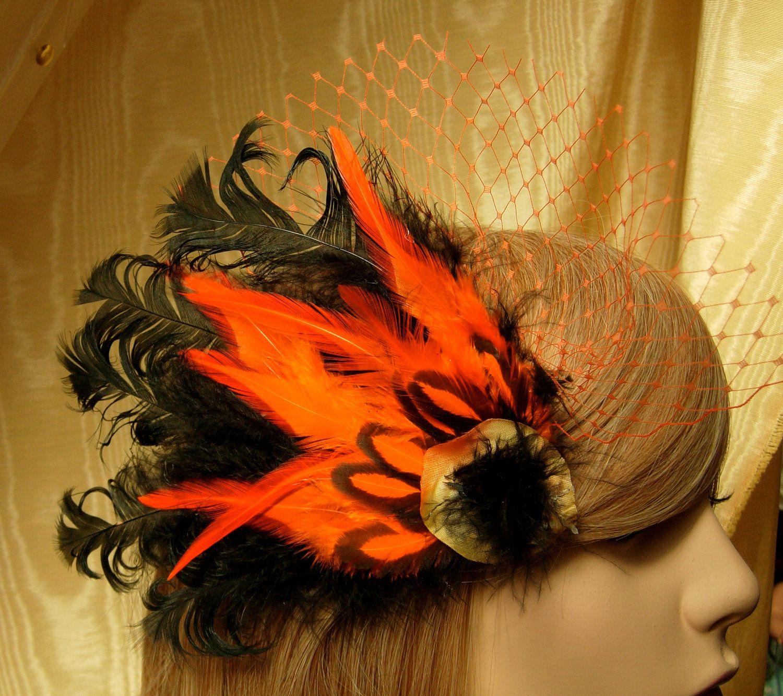 Black feather fascinator,Halloween fascinator,Costume fascinator,Pheasant feather fascinator,orange and black fascinator. $29.00, via Etsy.