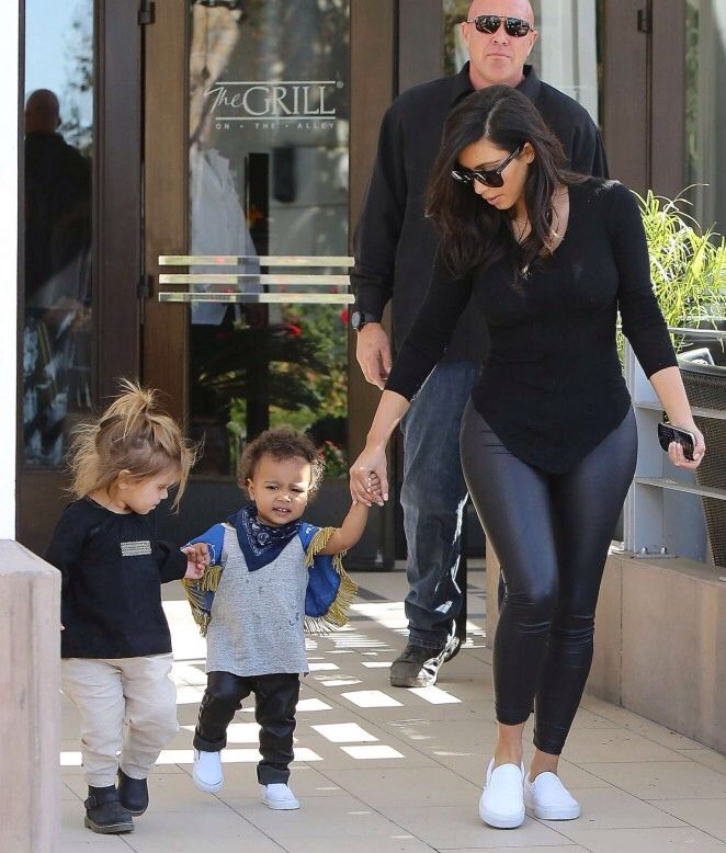 Kim kardashian and North Kardashian Why did she not speak up to useless I mean look at how see let him dress north she's dressed like a little boy it's almost as if he wanted a little boy instead