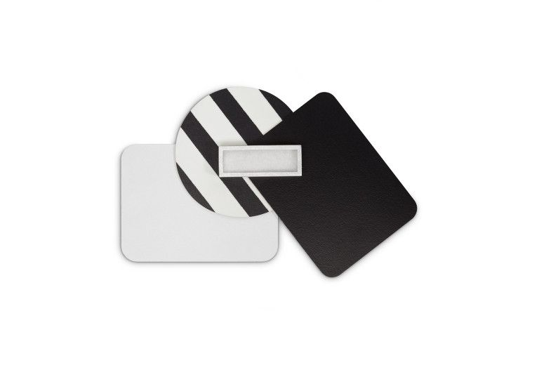 Brooch from the collection <em>laminati mille colori</em>. Composition black-white. Laminate, silver, felt.