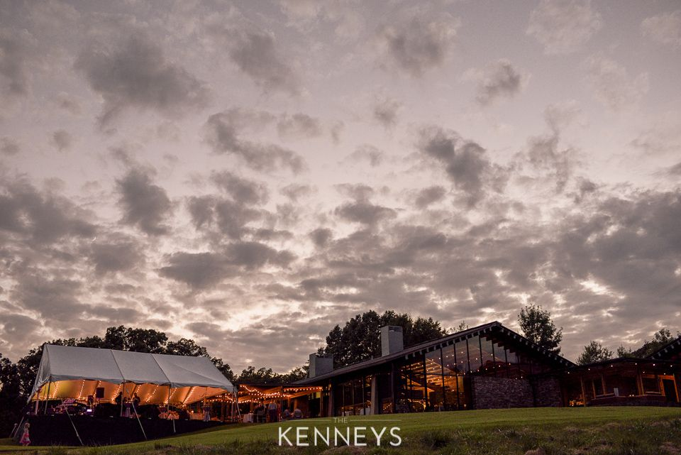 The Golf House at dusk. Rustic modern wedding venue in ...