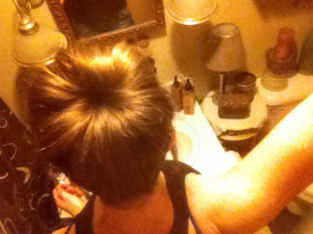 Sock Bun! Cut the toe of a sock off and roll the sock into a doughnut. Start with a tight pony tail. Take the sock and put your pony tail into the hole. Take it to the end of your pony tail and start to roll!! Perfect bun.
