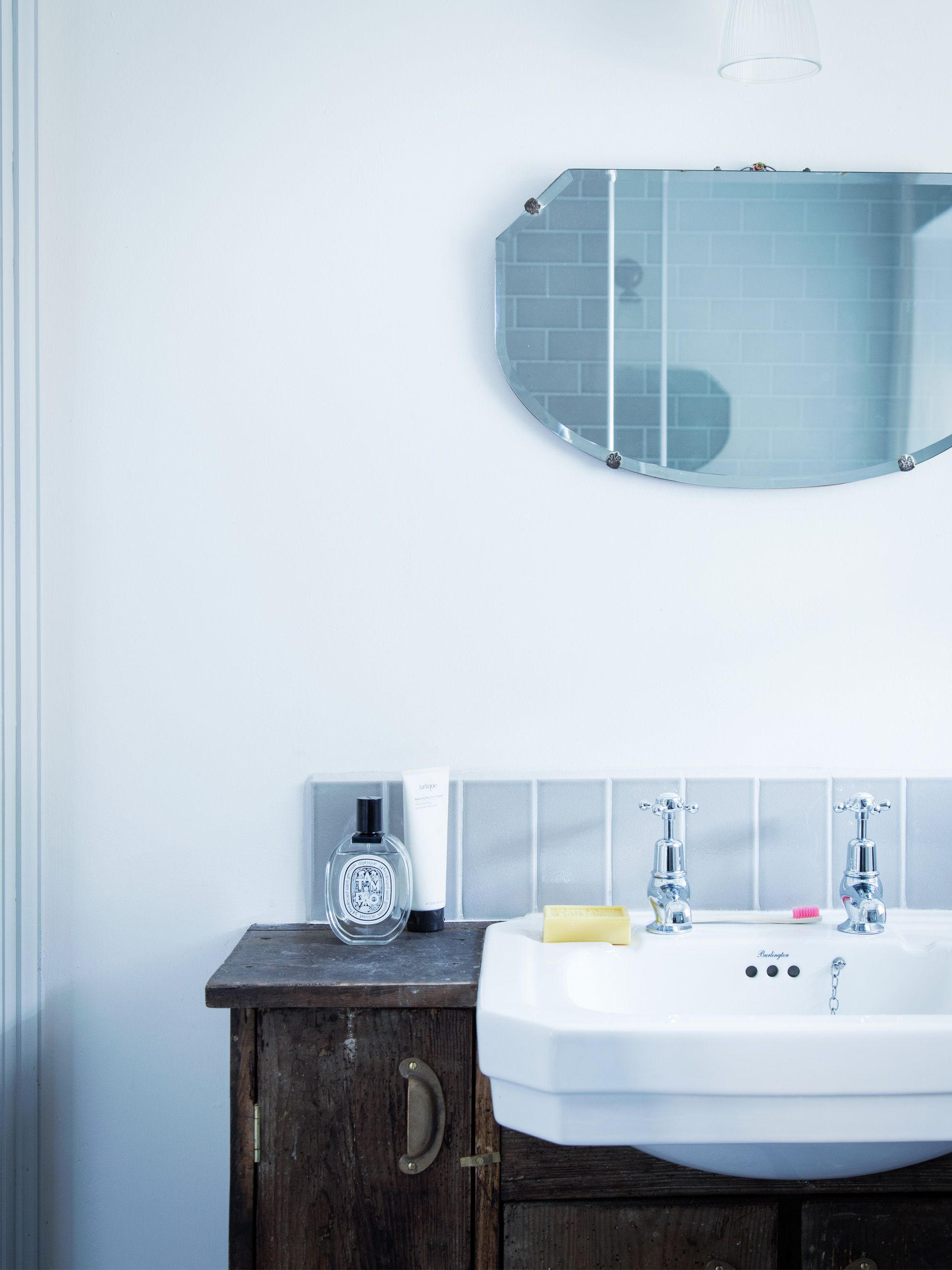 A custom made joinery unit hold a pedestal sink - Dorset Cottage ...