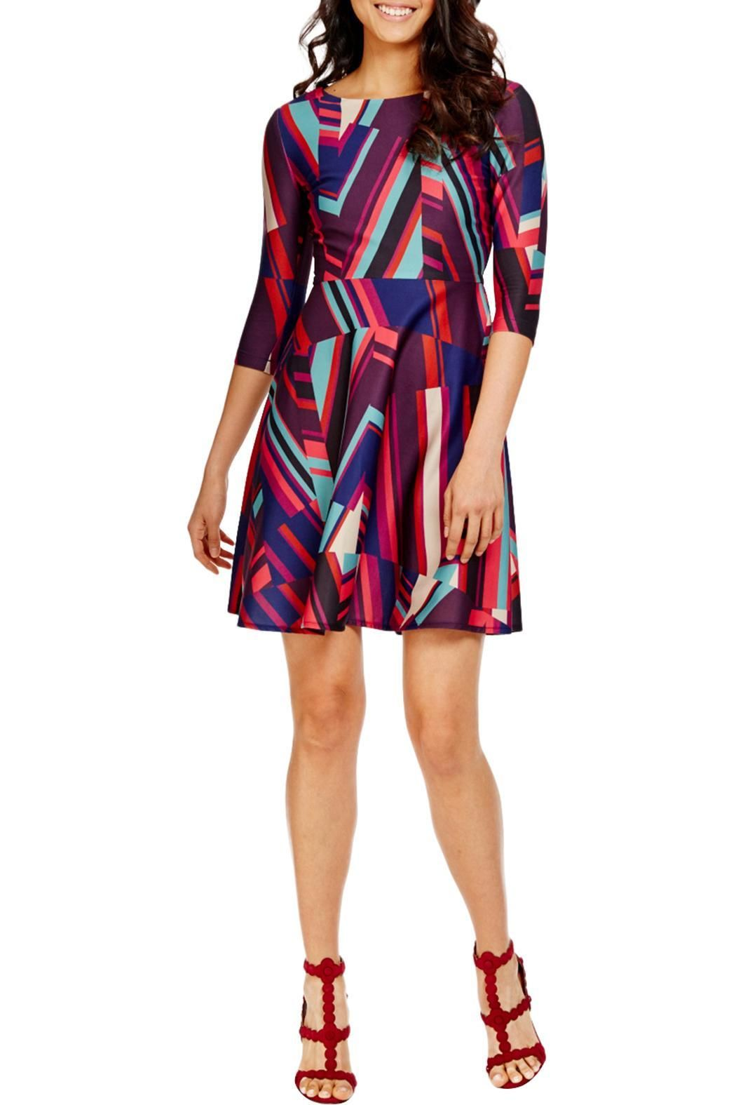 Belle abstract stripe fit and flare dress. This dress features a fit and flare silhouette which is one of our favorites but also boasts a vibrant geometric pattern that adds a chic twist. This dress features an invisible zipper.   Abstract Stripefit Flare Dress by Donna Morgan. Clothing - Dresses Rhode Island