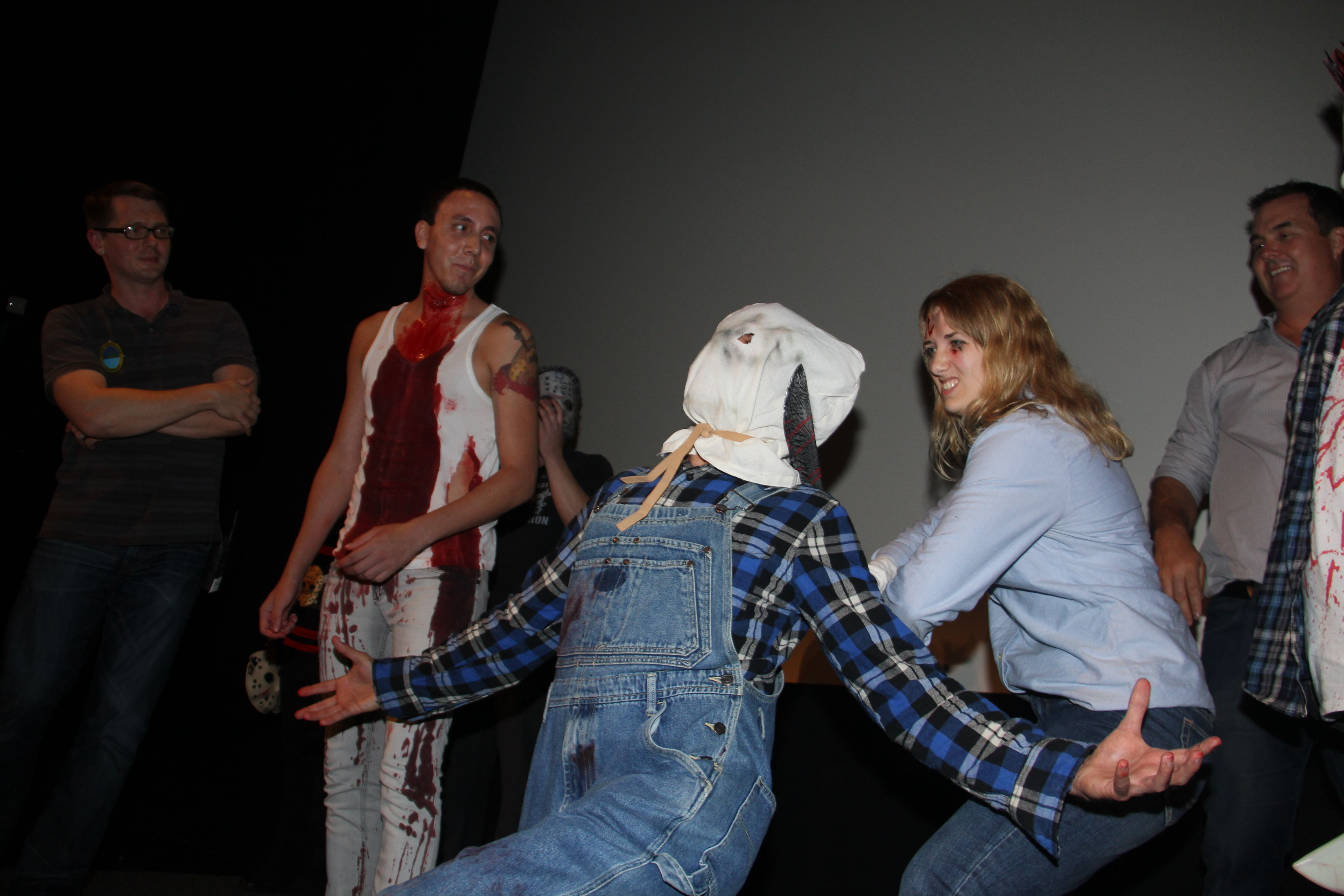 """A tribute to the original FRIDAY THE 13th, PART 2: my """"Ginny Fields"""" (my wife, Jennifer) sticks it to my """"Sackhead Jason Voorhees"""" during the 2nd Round of the Costume Contest!  PHOTO COURTESY LEE CHRISTIAN"""