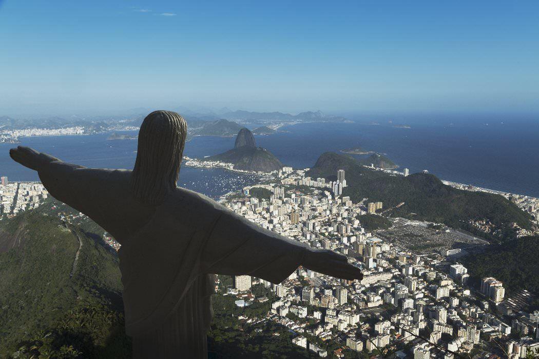 Cristo Redentor and the coastline.  Rio de Janeiro.  Brazil.  South America image gallery - Lonely Planet