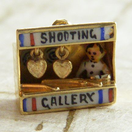 Tiny enameled shooting gallery charm