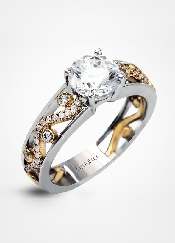 The intricate design of this modern two-tone engagement ring is accentuated by .17 ctw of glistening round cut white diamonds. Click to vire more fabulous engagement rings from Simon G. Jewelry.