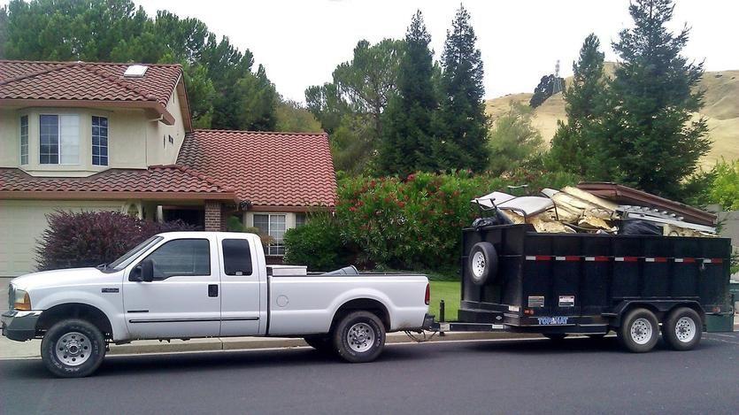 hauling trash away