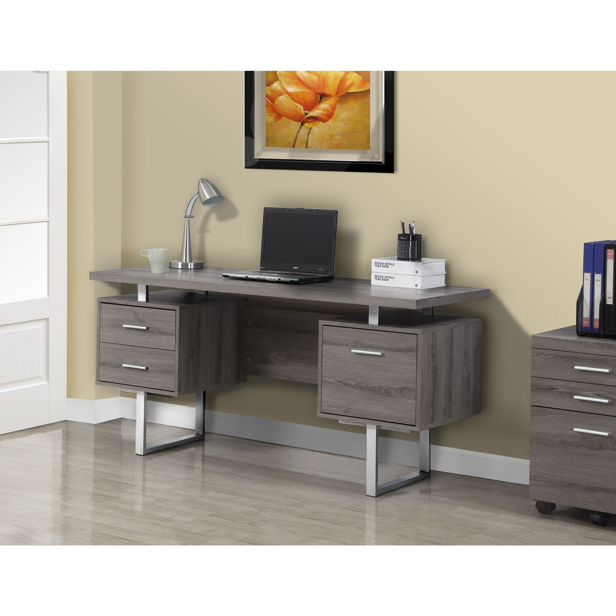 this dark taupe desk has the look of reclaimed wood making it well suited for the casual. Black Bedroom Furniture Sets. Home Design Ideas