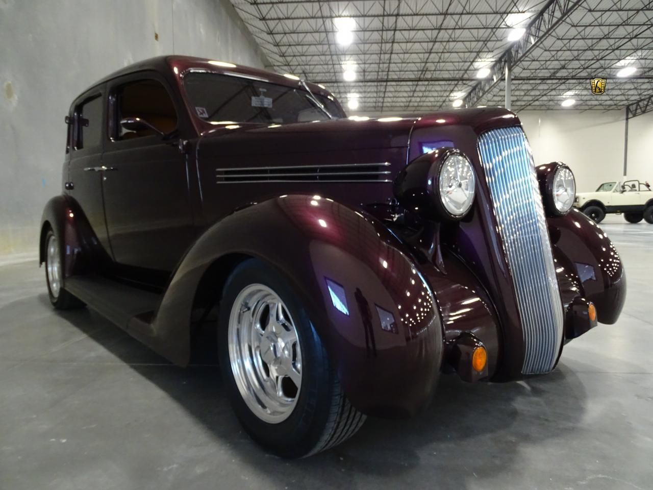 For sale in our Dallas, Texas showroom is a Purple 4 Door