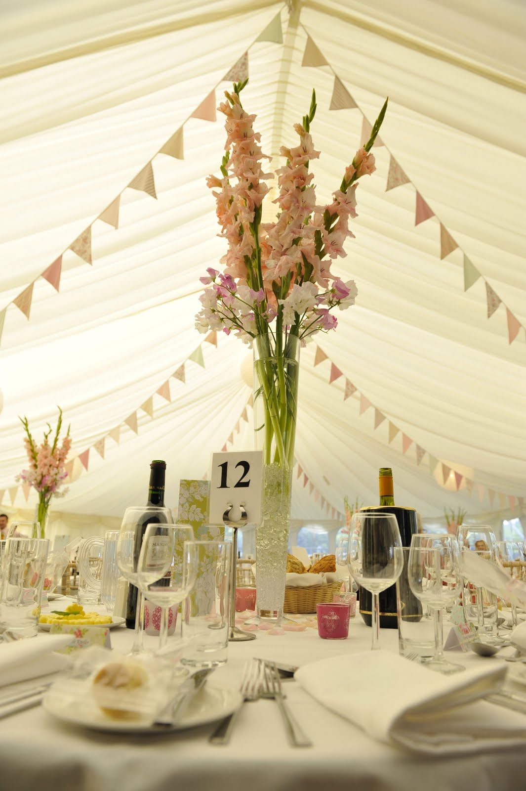 Pretty Bunting Makes An Inviting Marquee For A Wedding On The River Hamble In Hampshire Uk Wedding Centerpieces Gladiolus Centerpiece Wedding Flowers