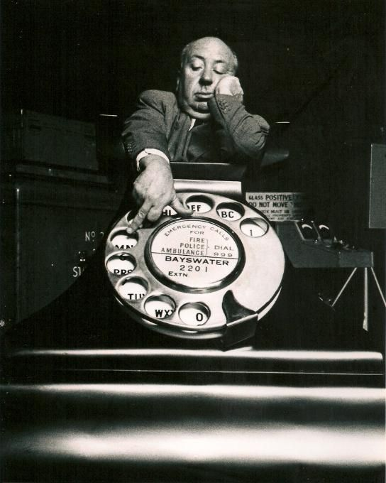 Alfred Hitchcock in a promotional still for Dial M for Murder