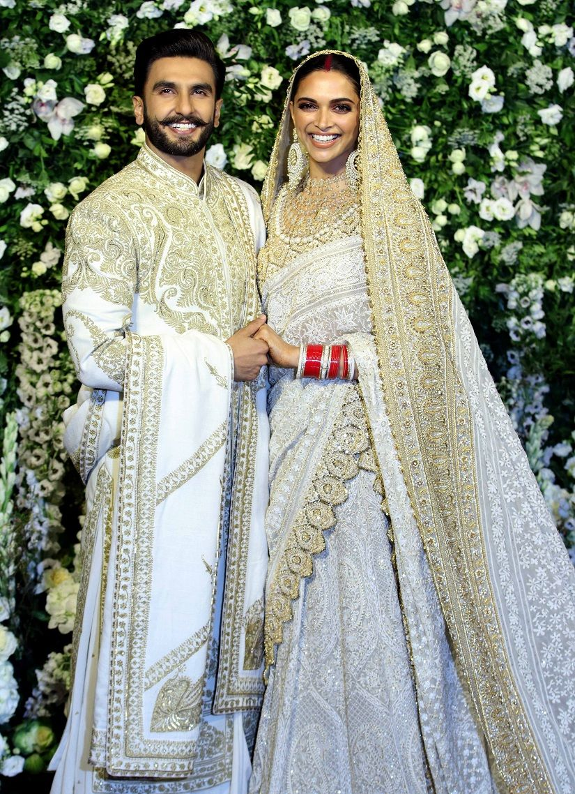 Deepika Padukone And Ranveer Singh Wore Matching White And Golden Sequinned Outfits For T Mumbai Wedding Couple Wedding Dress Indian Wedding Couple Photography