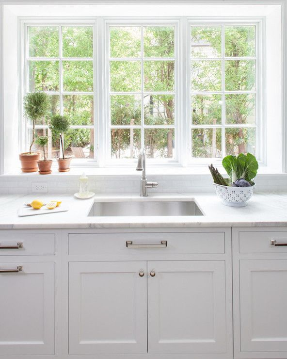 Kitchen Backsplash By Window beautiful kitchen features white shaker cabinets paired with