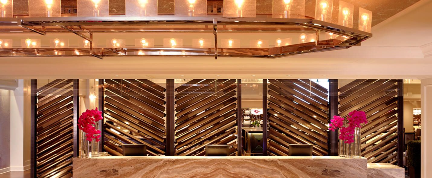 interesting louvered screen behind reception desk | hospitality