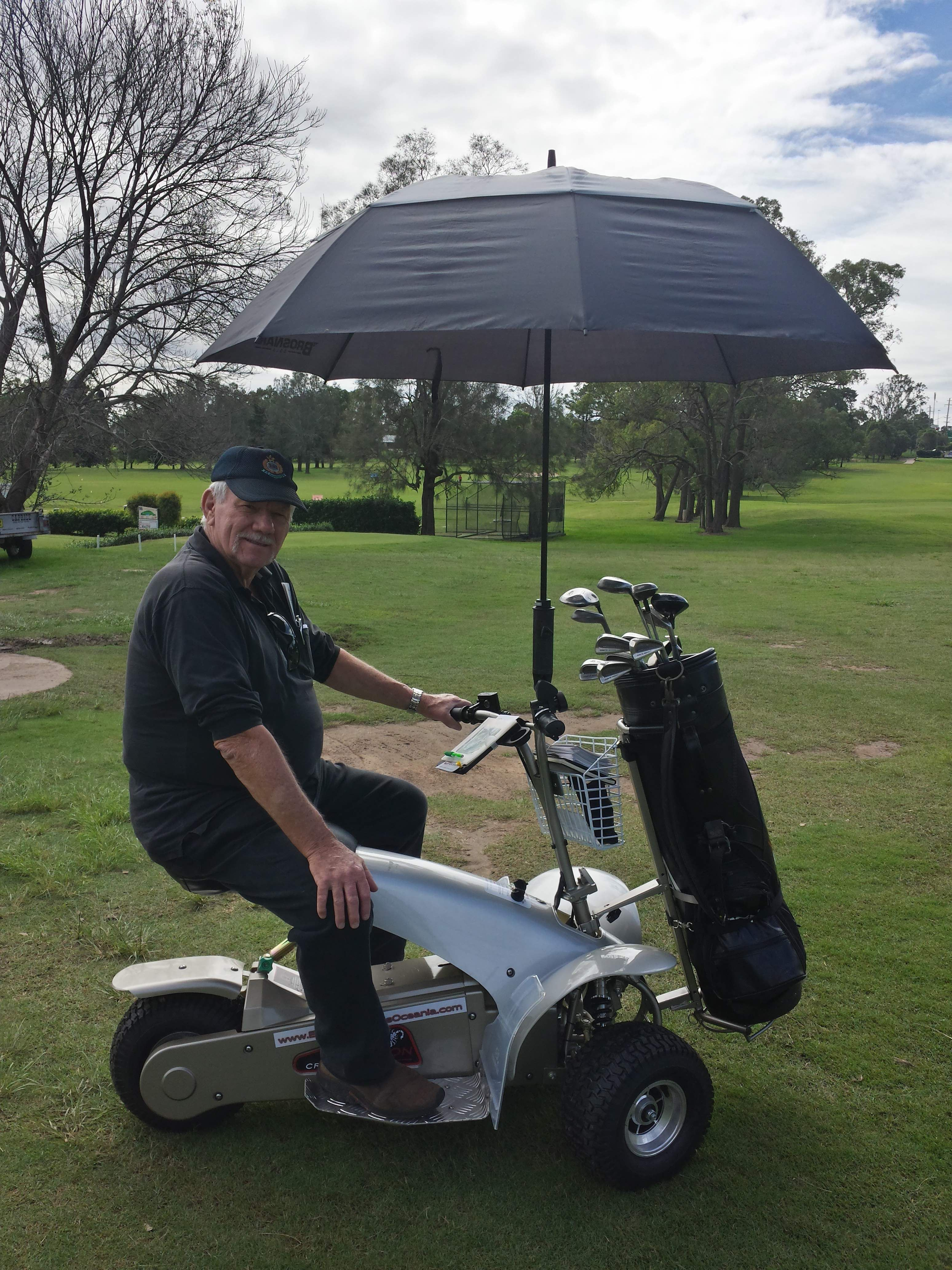 The umbrella holder on the golf cruiser will handle any