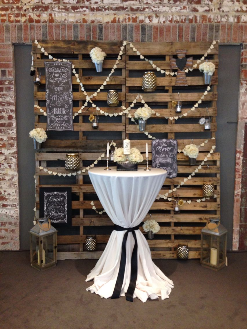 Our ceremony backdrop: pallet wall with flowers, candles ...