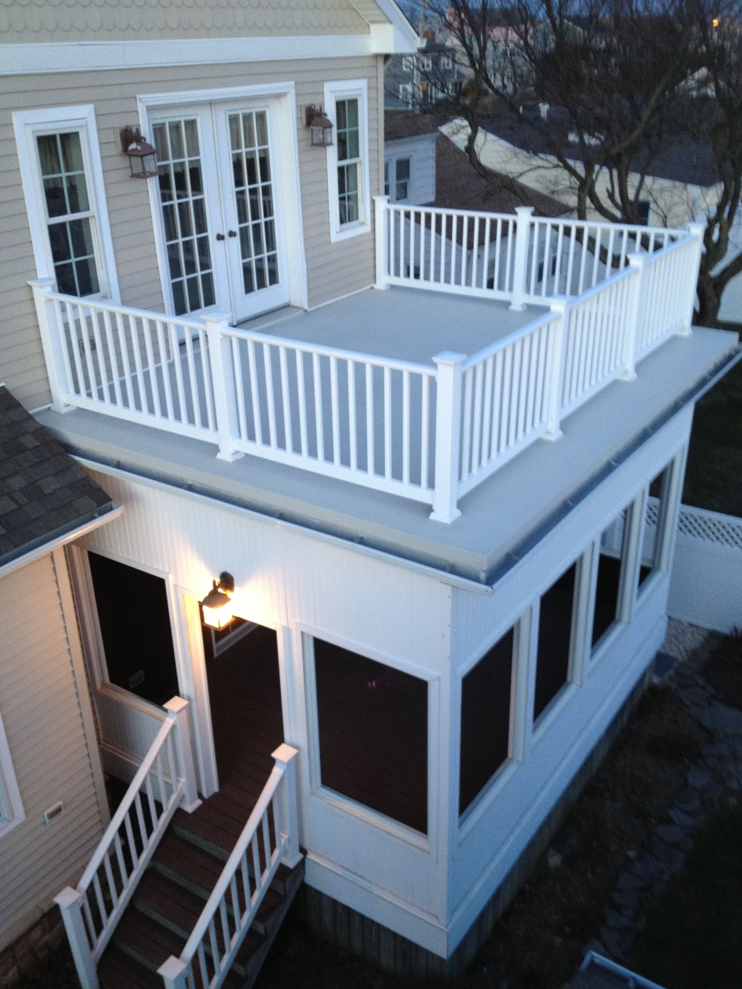 Flat Roof With Railings And A Screened In Porch. Wife Can