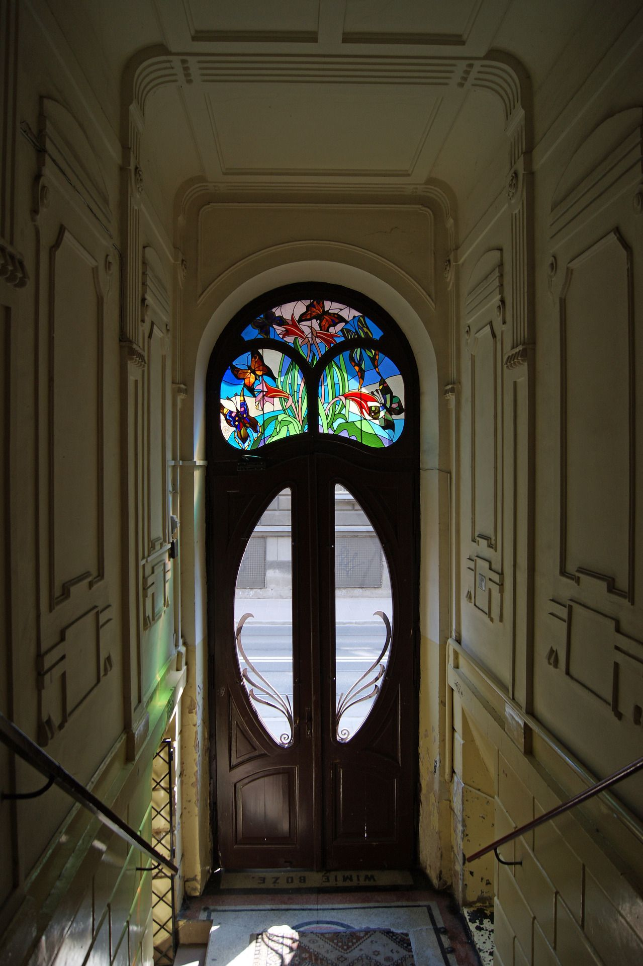 Art Nouveau Architecture in Krakow, Poland: Tenement door with stained glass, 1906
