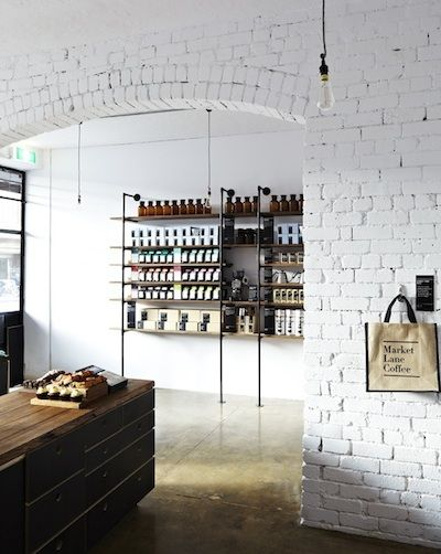 Opening shelving from raw pipes and wood + A coffee shop in Melbourne, Australia called Market Lane Coffee