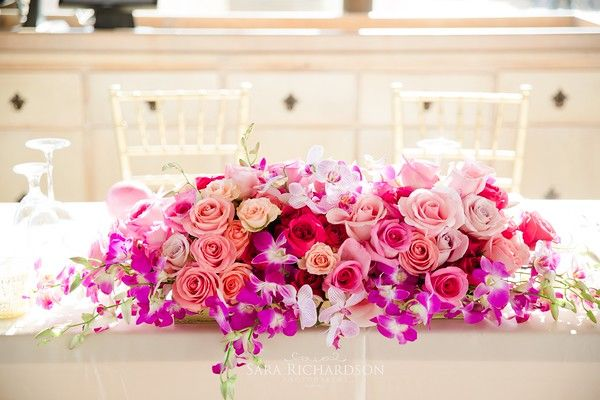 Beautiful Sweethear Table Centerpiece with Orchids & Roses #SunsetMonaLisa #Orchids #Cymbidiums #Roses #ColorfulWedding #Beautiful #Flowers #WeddingFlowers #SweetheartTable #Ideas #BestDestinationWedding #DestinationWeddings #Love #LosCabos #Mexico #CaboSanLucas