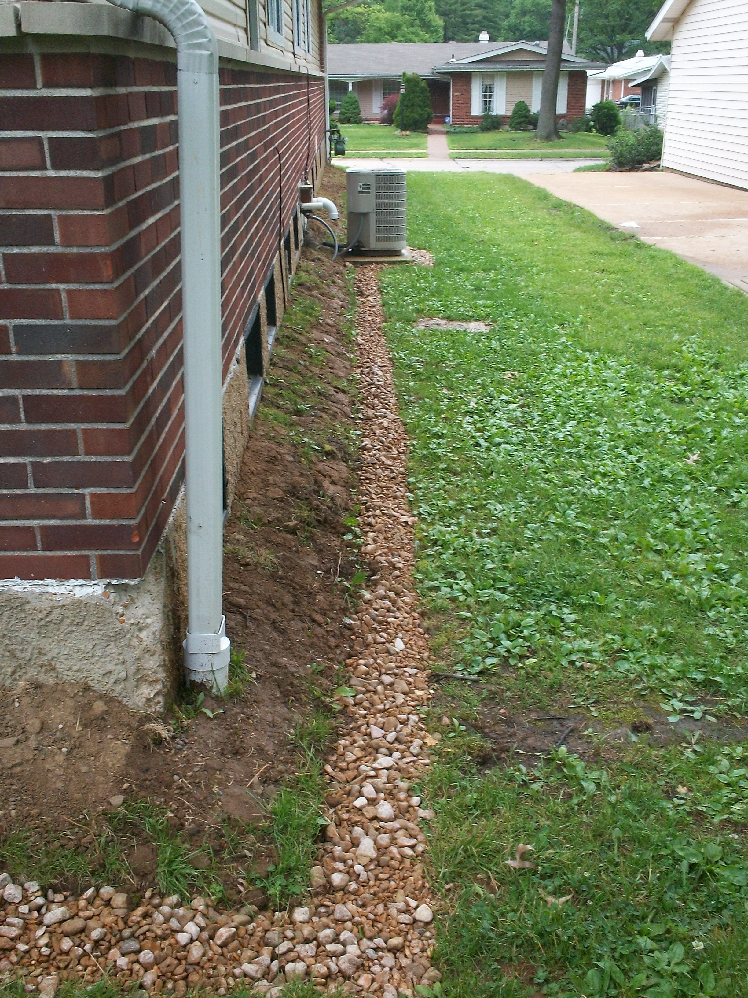 French drain and downspout extensions divert rainwater for Outdoor ground drains