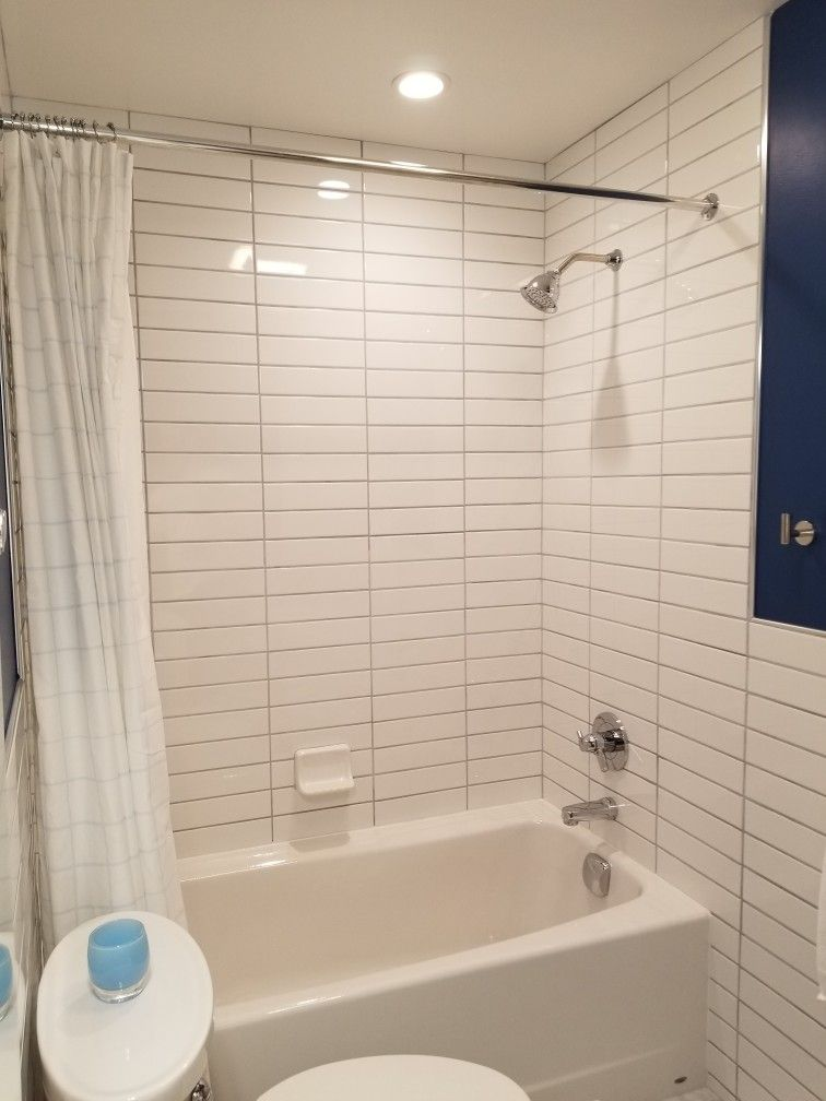 American standard cambridge tub, tile from tub to ceiling. White ...