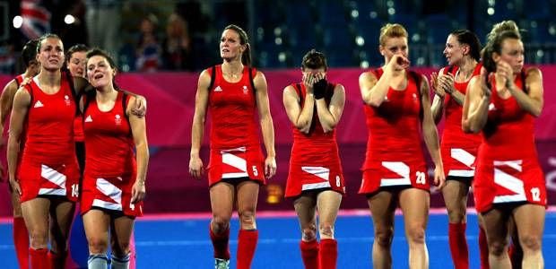 Great Britain's Helen Richardson (centre) holds her face after defeat to Argentina at the Hockey Centre, London.