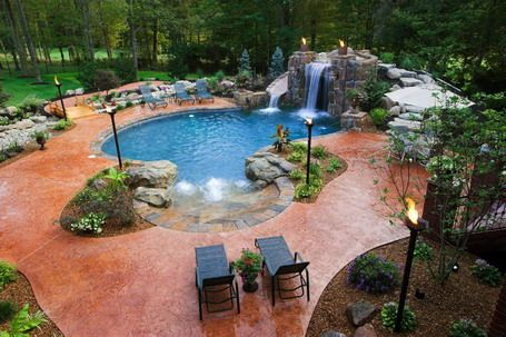 Tropical Patio Design Ideas with Grotto and Pool and Chaise Lounge ...
