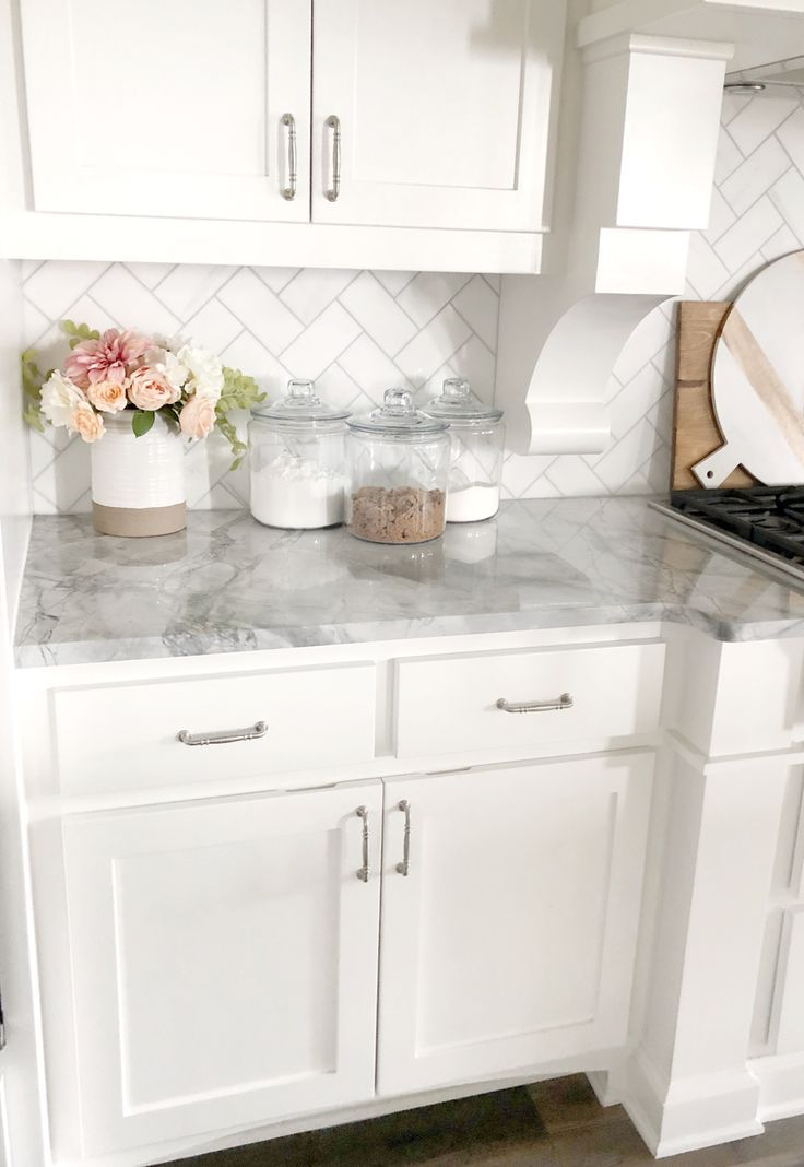 white kitchen with gray marble counter top and white subway tile back splash #whitekitchen #farmhousestyle #kitchenideas #graycabinets