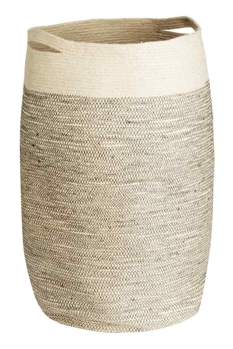 Panier à linge en jute: Panier à linge en jute avec double poignée. Diamètre 35 cm environ, hauteur 65 cm.