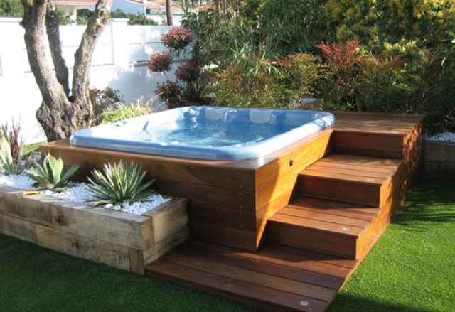 A Jacuzzi With Wooden Steps And A Wooden Planter With Succulents Around In 2020 Hot Tub Patio Hot Tub Landscaping Hot Tub Backyard