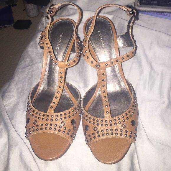 Silver Studded brown pumps Small 2 1/2 inch pumps with cute silver studs! Open toed with a strap down the middle. These would go cute with a casual pair of jeans or a cute little dress! ☺️ ANTONIO MELANI Shoes Heels