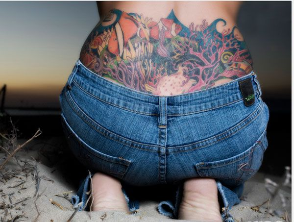 Lower back tattoo cover up designs there is an ocean for Tattoo on buttocks
