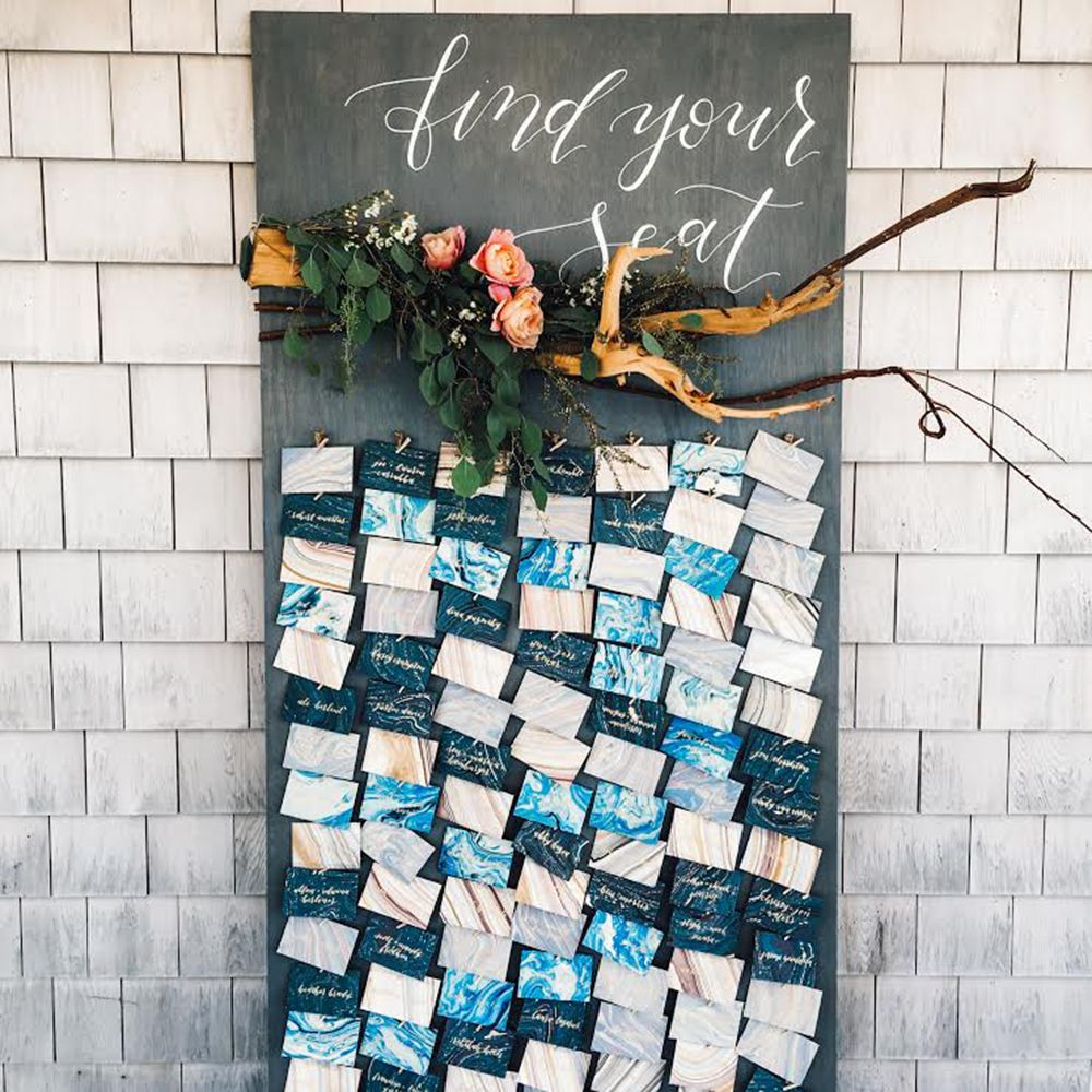 unique seating charts - photo by Cambria Grace Photography http://ruffledblog.com/italian-marbling-inspired-beach-wedding