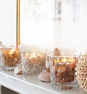 Beach Pebble Tea Lights. Place a small, shallow tealight holder at the bottom of a sturdy glass tumbler then arrange small pebbles and glass pieces around it.