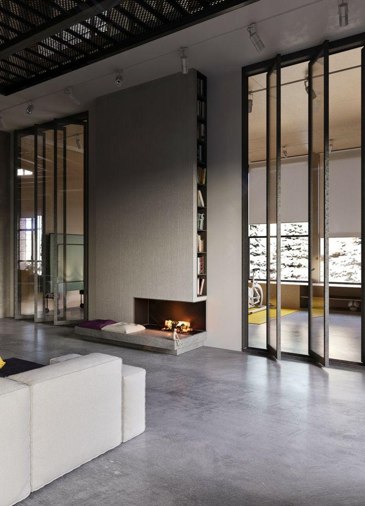 wohnzimmer loft stil beton fußboden kamin bücherregal glas stahl