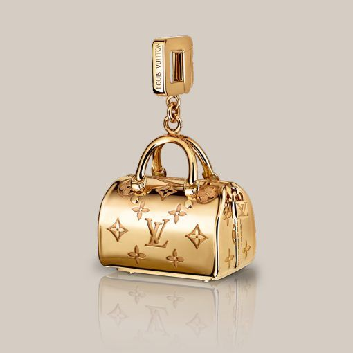 speedy empreinte charm in yellow gold the iconic charms collection was inspired by louis vuitton