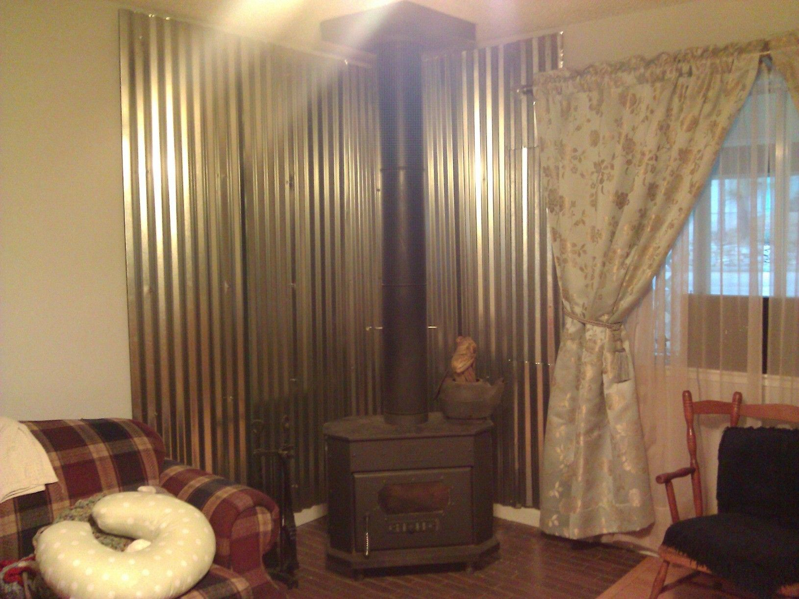 Out Diy Wood Stove Heat Shield Very Rustic And Works Like A Charm Not To Replace The Curtains Wood Stove Heat Shield Wood Heater Wood Stove Wall