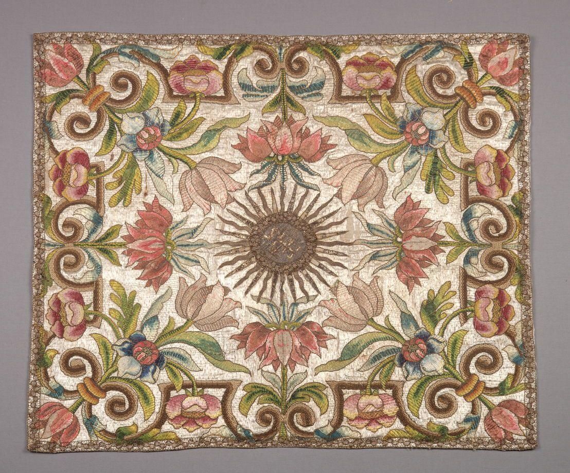 Chalice veil brown sunburst center with pink blue green flowers