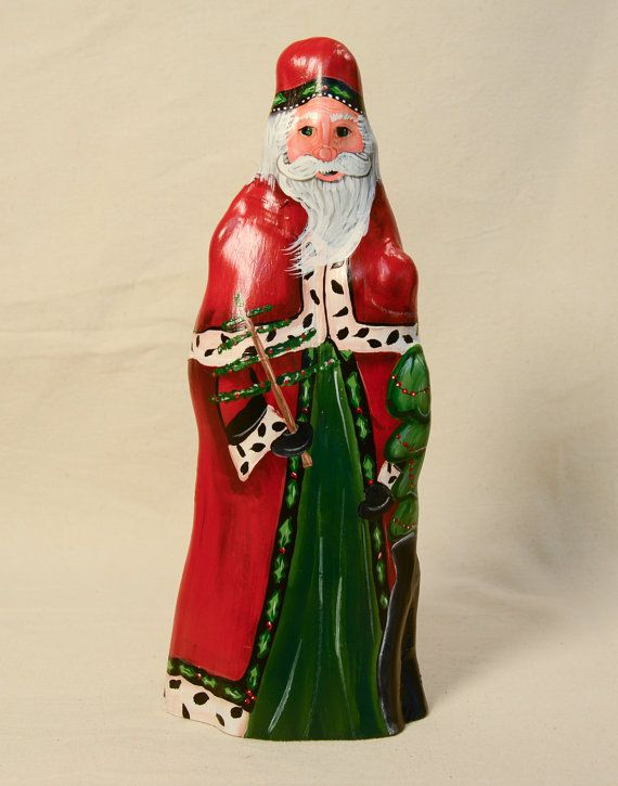 This one-of-a-kind, Cypress Knee Santa is the perfect gift for the Santa collector in your life. This Santa is wearing a traditional red coat with ermine trim and hat with holly trim. Theres a full bag of gifts with a Christmas tree sticking out. He is holding a feather tree. This Santa is 10 inches tall and 4 inches across the widest part of the base. Bald Cypress Trees grow in the swamps in Southeastern U.S. As the trees mature, extensions of the root system grow above the water or ground…