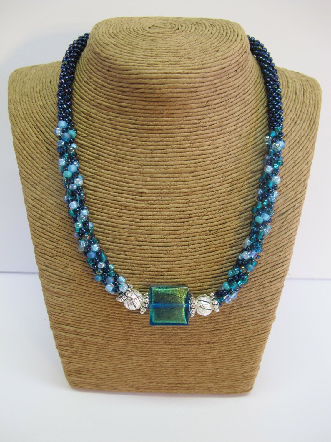 "19"" Kumihimo necklace with irredesent green Italian millifiori glass focal bead. by RosesKumihimo on Etsy https://www.etsy.com/listing/212279015/19-kumihimo-necklace-with-irredesent"